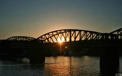 Prague railway bridge with sunset